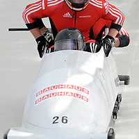 28 February 2007:    The Monaco bobsled driven by Patrice Servelle with sidepushers Petr Narovec and Sebastien Gattuso, and brakeman  Alexandre Vanhoutte jump into the sled at the start of the 2nd run at the 4-Man World Championships competition on February 27 at the Olympic Sports Complex in Lake Placid, NY.
