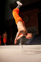 © London News Pictures. 08/06/2011. Tumbridge Wells, UK.  A rare, behind the scenes, view of the world famous Shaolin Warriors performing there warm up routine before going on stage at the Assembly Halls theatre, Tunbridge Wells. The performance showcases the rarely-seen Kung Fu masters' feats of agility, strength and skill as they embark on their gruelling 66 date tour. The troop contains 22 fully trained Kung Fu masters upwards from age 10. Picture credit should read Manu Palomeque/London News Pictures