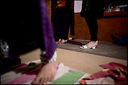 "Details of feet in the dressing room of a common ..apartment shared by five transvestites,  friends belong to the middle class. Late afternoon in south Rawalpindi, Pakistan on Friday, November 28 2008.....""Not men nor women"". Just Hijira, Kusra. Painted lips, Kajal surrounding ..their eyes and colourful veils..Pakistan is today considered a strongly, foundamentalist as well, ..islamic country. But under its reputation, above all over the talebans' ..continuos advancing, stirs a completely extraneous world, a multiethnic ..mixed society. Transvestites make part of it, despite this would not be ..admitted by a strict law..Third gender, the Hijira are born as men (often ermaphrodites) or with ..an ambiguous genital situation, and they have their testicles and penis ..removed through a - often brutal - surgical operation. The peculiarity ..is that this operation does not contemplate the reconstruction of a ..female organ. This is the reason why they are not considered as men nor ..women, just Hijira. They are often discriminated, persecuted  and taxed ..with being men prostitutes in the muslim areas. The members of this ..chast perform dances during celebrations, especially during weddings, ..since it is anciently believed that an EUNUCO's dance and kiss in the ..wedding day brings good luck to the couple's fertility...To protect the identities of the recorded subjects names and specific ..places are fictionals."