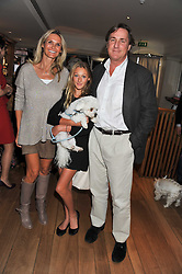 ERIC & ALEXANDRA HERSMAN, their daughter ELIZABETH and their dog Sushi at the 10th anniversary of George in association with The Dog's Trust held at George, 87-88 Mount Street, Mayfair, London on 13th September 2011.