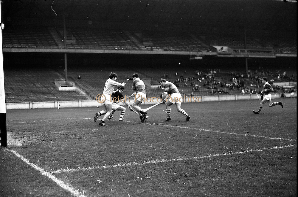 05/10/1969<br /> 10/05/1969<br /> 5 October 1969<br /> All-Ireland Junior (Home) Final: Kerry v Antrim at Croke Park, Dublin. <br /> Kerry full-forwards, J. Lyannan (center) and W. McCarthy put the Antrim goal under heavy attack. J. Mulhalland (2), the Antrim full-back,  helps the Antrim keeper in the goalmouth.