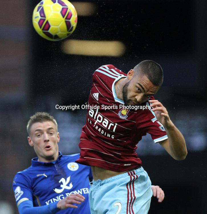 20 December 2014. Premiership. West Ham v Leicester.<br /> Winston Reid of WestHam twists to successfully head the ball.<br /> Photo: Charlotte Wilson