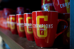 """LIVERPOOL, ENGLAND - Monday, August 3, 2020: Coffee mugs featuring """"Champions of Europe"""" on display in the Liverpool FC retail store. (Pic by David Rawcliffe/Propaganda)"""