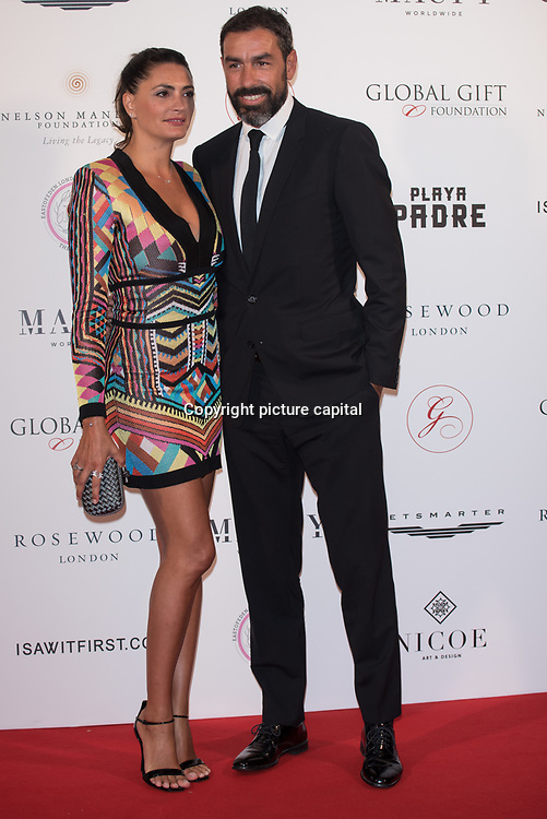 Robert Pires and Jessica Lemarie-Pires Arrive The Nelson Mandela Foundation hosts dinner in memory of Nelson Mandela on what would have been the day before his 100 birthday on 24 April 2018 at Rosewood Hotel, London, UK.