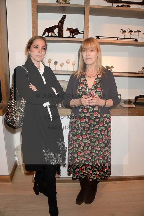 Left to right, LADY LIZA CAMPBELL and JO FARRELL at a reception to launch Prestat's special edition of their award-winning chocolate bars to raise money for the charity Walking with the Wounded held at Sladmore Gallery, Bruton Place, London on 10th October 2013.