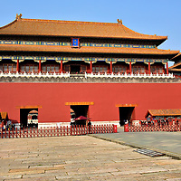 Meridian Gate at Forbidden City in Beijing, China<br /> Located behind Tiananmen Square is the southern and main entrance to Forbidden City. The name Meridian Gate is derived from the word for the longitudinal circle around the earth. Emperors believed they were the Sons of Heaven and therefore should live at the center of the universe. In Chinese, it is called Wumen. This impressive structure with five towers &ndash; this central one is tallest at 124 feet - was part of the original construction ending in 1420. Feel privileged when you walk through the middle of its five portals. For hundreds of years, this entry was reserved for the emperor. The empress was only allowed to walk along Imperial Way on her wedding day.