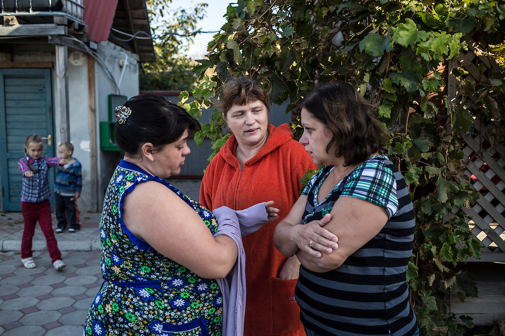 A group of internally displaced people who fled the besieged city of Donetsk in the small seaside resort that has become their home on Tuesday, October 14, 2014 in Berdyansk, Ukraine. Photo by Brendan Hoffman, Freelance