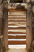 SIEM REAP, CAMBODIA - AUGUST 10, 2008: View to the old staircase in the Bakong temple in Siem Reap, Cambodia.