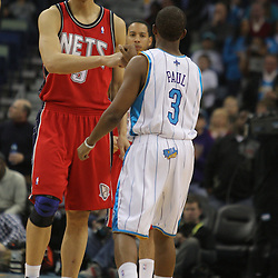 Jan 08, 2010; New Orleans, LA, USA; New Jersey Nets forward Yi Jianlian greets New Orleans Hornets guard Chris Paul (3) prior to tip off of a game against the New Orleans Hornets at the New Orleans Arena. The Hornets defeated the Nets 103-99. Mandatory Credit: Derick E. Hingle-US PRESSWIRE.