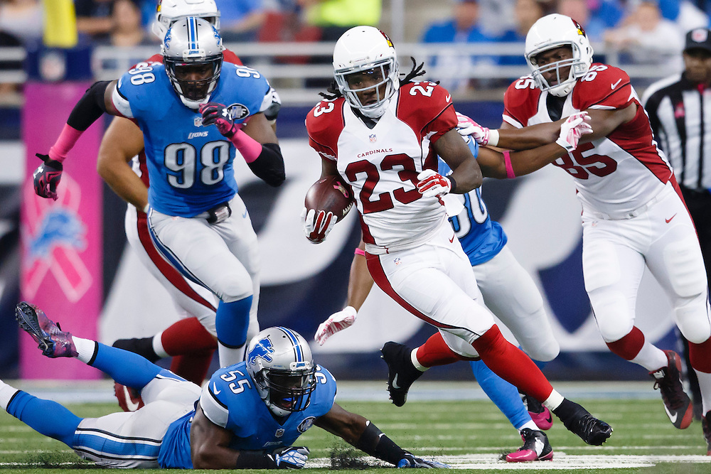 Arizona Cardinals running back Chris Johnson (23) rushes against the Detroit Lions during an NFL football game at Ford Field in Detroit, Sunday, Oct. 11, 2015. (AP Photo/Rick Osentoski)