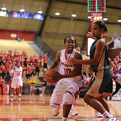 Jan 31, 2009; Piscataway, NJ, USA; Rutgers guard Epiphanny Prince (10) drives against South Florida forward Porche Grant (11) during the closing minutes of South Florida's 59-56 victory over Rutgers in NCAA women's college basketball at the Louis Brown Athletic Center