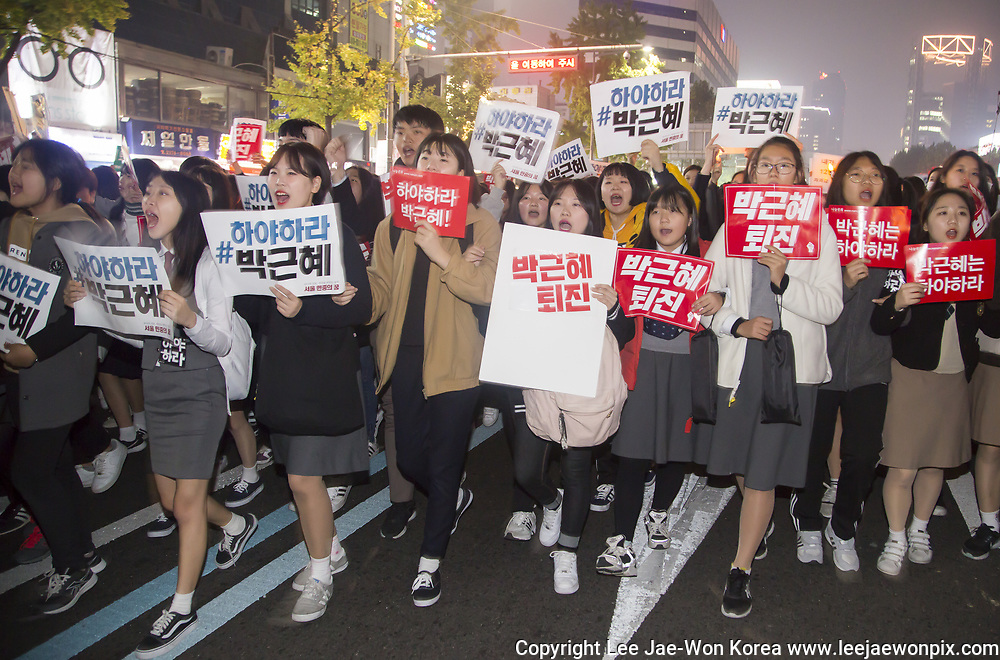 "Middle and high school students attend a rally demanding South Korean President Park Geun-hye's resignation in Seoul, South Korea, Nov 5, 2016, a day after President Park said she will accept an investigation over a corruption scandal involving her confidante Choi Soon-sil. Tens of thousands of people marched in central Seoul after a rally as they demanded Park's resignation over a corruption scandal involving Choi who allegedly meddled in state affairs and pursued unlawful benefits for herself, local media reported. The Police said about 43,000 people gathered while organizers of the rally said about 150,000 people attended the rally. Signs read,""Park Geun-hye resign"". Photo by Lee Jae-Won (SOUTH KOREA) www.leejaewonpix.com"