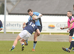 Westport's Andrew McAleer gets a tackle in on Galwegians Matt Dever during the junior Cup final.<br /> Pic Conor McKeown