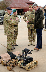 © Licensed to London News Pictures. 09/03/2012. Copedown Hill, UK. Secretary of Defence Philip Hammond looks at equipment for clearing IED's as he visits troops during the day. The 12thMechanized Brigade (12 Mech Bde) at Copehill Down, Salisbury Plain Training Area, Wiltshire,on FRIDAY 09 MARCH 2012, as it prepares to deploy to Helmand Province, Afghanistan, on Operation Herrick 16, in the Spring of this year. The Brigade were performing a dynamic demonstration of combined Afghan/ISAF operations supported by surveillance assets and casualty evacuation capability. Tornado GR4 fast jest ground support was also displayed.. Photo credit : Stephen SImpson/LNP
