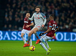 LONDON, ENGLAND - Monday, February 4, 2019: Liverpool's Adam Lallana and West Ham United's Issa Diop during the FA Premier League match between West Ham United FC and Liverpool FC at the London Stadium. (Pic by David Rawcliffe/Propaganda)