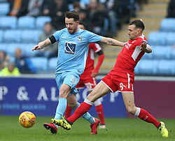 Coventry City's Marc McNulty and Swindon Town's James Dunne battle for the ball