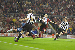 LIVERPOOL, ENGLAND - WEDNESDAY, SEPTEMBER 20th, 2006: Newcastle United's Celestine Babayaro handles the ball in the penalty area but no penalty was given as Liverpool's Dirk Kuyt looks on during the Premiership match at Anfield. (Pic by David Rawcliffe/Propaganda)