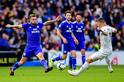 Joe Ralls of Cardiff City is tackled by Johann Gudmundsson of Burnley  Mandatory by-line: Ryan Hiscott/JMP - 30/09/2018 -  FOOTBALL - Cardiff City Stadium - Cardiff, Wales -  Cardiff City v Burnley - Premier League