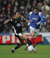 Photo: Lee Earle.<br /> Portsmouth v Wigan Athletic. The FA Cup. 06/01/2007. Wigan's Denny Landzaat (L) tackles Nico Kranjcar.
