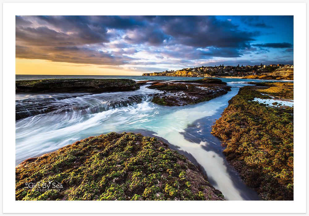 Sydney's eastern suburbs basking in the spring sunshine. View from Tamarama towards Bronte, NSW, Australia.<br /> <br /> To purchase please email orders@girtbyseaphotography.com quoting the image number PB202370, and your preferred print size. You will receive a quick reply recommending print media options to best suit your chosen image, plus an obligation-free quotation. Current standard size prices are published on the Pricing page.