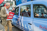 A leave supporter hands out stickers to cab drivers on Westminster Bridge - Nigel Farage, the leader of Ukip, joins a flotilla of fishing trawlers up the Thames to Parliament to call for the UK's withdrawal from the EU, in a protest timed to coincide with prime minister's questions.