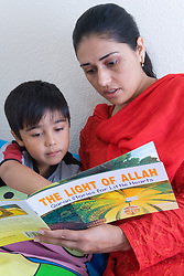 Mother reading a book to her son,