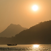 sunset on the Mekong River near Luang Prabang, Laos.