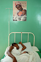 1985, Port-au-Prince, Haiti --- A mother and a newborn share a bed in a slum charity hospital in Port au Prince, Haiti. --- Image by © Owen Franken/CORBIS