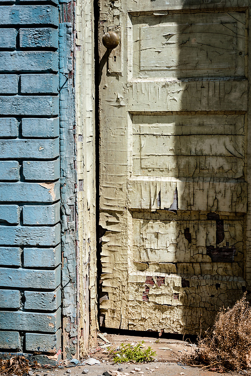 Weathered aqua painted bricks frame a section of an equally weathered door on the side of an abandoned filling station.  The textures in this old door are really cool.  Orignally, I was going to make this a black & white image but decided I like the color version much better.