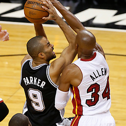 Jun 20, 2013; Miami, FL, USA; San Antonio Spurs point guard Tony Parker (9) is defended by Miami Heat shooting guard Ray Allen (34) during the first quarter of game seven in the 2013 NBA Finals at American Airlines Arena. Mandatory Credit: Derick E. Hingle-USA TODAY Sports