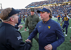 Nov 10, 2018; Morgantown, WV, USA; West Virginia Mountaineers head coach Dana Holgorsen talks with TCU Horned Frogs head coach Gary Patterson after the game at Mountaineer Field at Milan Puskar Stadium. Mandatory Credit: Ben Queen-USA TODAY Sports