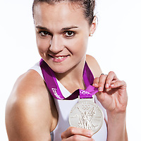 14 August 2012:  Olympic Silver Medalist Clemence Beikes (Team France Basketball) poses with her silver medal, at the Hotel Concorde Lafayette, in Paris, France.