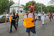 """Rylea Henderson (top), 10, and her dad, Danny Henderson, both of Cedar Rapids, participate in the """"Stop the Violence March"""" in Cedar Rapids on Saturday afternoon, May 19, 2012. The march was organized by a group of people fed up with the recent violence. About 90 people participated in the march with many people joining along the way. They plan on organizing a march monthly in various parts of town where there has been recent violence. (Stephen Mally/Freelance)"""