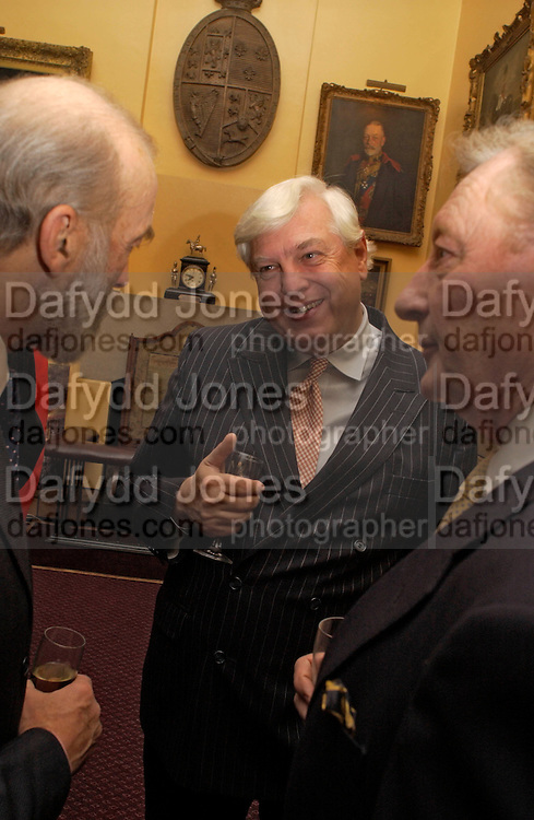 Prince Michael of Kent, John Simpson and John Smith, Reception to support the Hyde Park Appeal for Liberty Drives ( a charity which enables people to travel around Hyde Park in electric buggies) in the presence of Prince Michael of Kent. Officers Mess. Household Cavalry Mounted Regiment. Hyde Park Barracks. 30 November 2004. ONE TIME USE ONLY - DO NOT ARCHIVE  © Copyright Photograph by Dafydd Jones 66 Stockwell Park Rd. London SW9 0DA Tel 020 7733 0108 www.dafjones.com