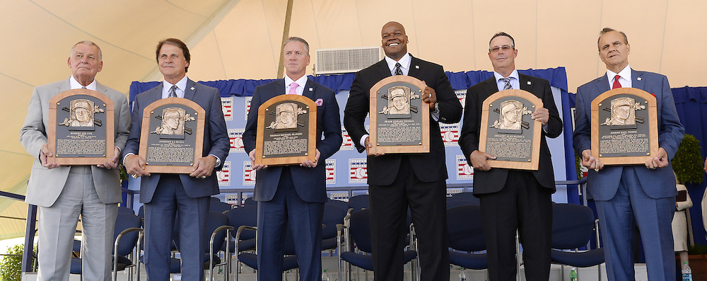 COOPERSTOWN, NY - JULY 27:  2014 Baseball Hall of Famer inductees (from left to right) Bobby Cox, Tony LaRussa, Tom Glavine, Frank Thomas, Greg Maddux and Joe Torre pose for a photo with their Hall of Fame Plaques following the 2014 HOF induction ceremonies held at the Clark Sports Center in Cooperstown, New York on July 27 2014.