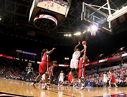 Virginia center Aisha Mohammed (33) shoots over N.C. State forward Khadijah Whittington (1).  The Virginia Cavaliers defeated the NC State Wolfpack women's basketball team 74-49 at the John Paul Jones Arena in Charlottesville, VA on February 1, 2008.