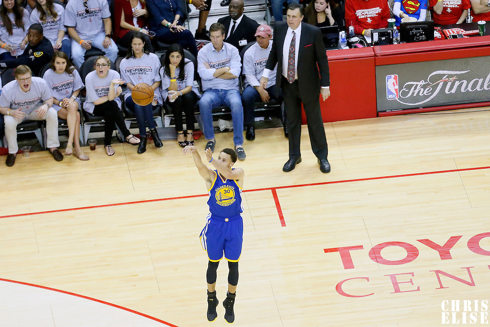 23 May 2015: Golden State Warriors guard Stephen Curry (30) tales a jump shot in front of Houston Rockets head coach Kevin McHale during the Golden State Warriors 115-80 victory over the Houston Rockets, in game 3 of the Western Conference finals, at the Toyota Center, Houston, Texas, USA.