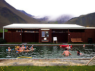 Bathers enjoying the algae thermal pool at Snaefellsbaer, along the Snæfellsnes Peninsula, Iceland, 2017.