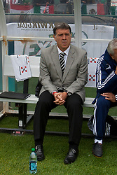 March 26, 2011; Oakland, CA, USA;  Paraguay head coach Gerado Martino sits on the bench before the game against Mexico at Oakland-Alameda County Coliseum. Mexico defeated Paraguay 3-1.