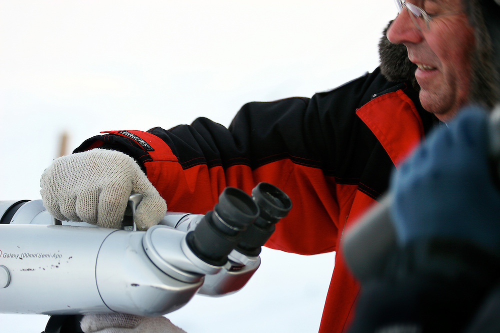Jens Magnussen sets up high-powered binoculars during a trek in search of musk oxen and caribou outside Kangerlussauq, Greenland.
