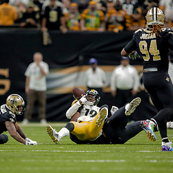 Dec 23, 2018; New Orleans, LA, USA; New Orleans Saints defensive tackle Sheldon Rankins (98) forces a fumble by Pittsburgh Steelers wide receiver JuJu Smith-Schuster (19) during the fourth quarter at the Mercedes-Benz Superdome. Mandatory Credit: Derick E. Hingle-USA TODAY Sports