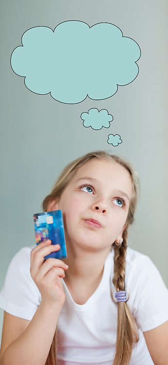 Pensive young girl holding credit card with speech bubble over gray background