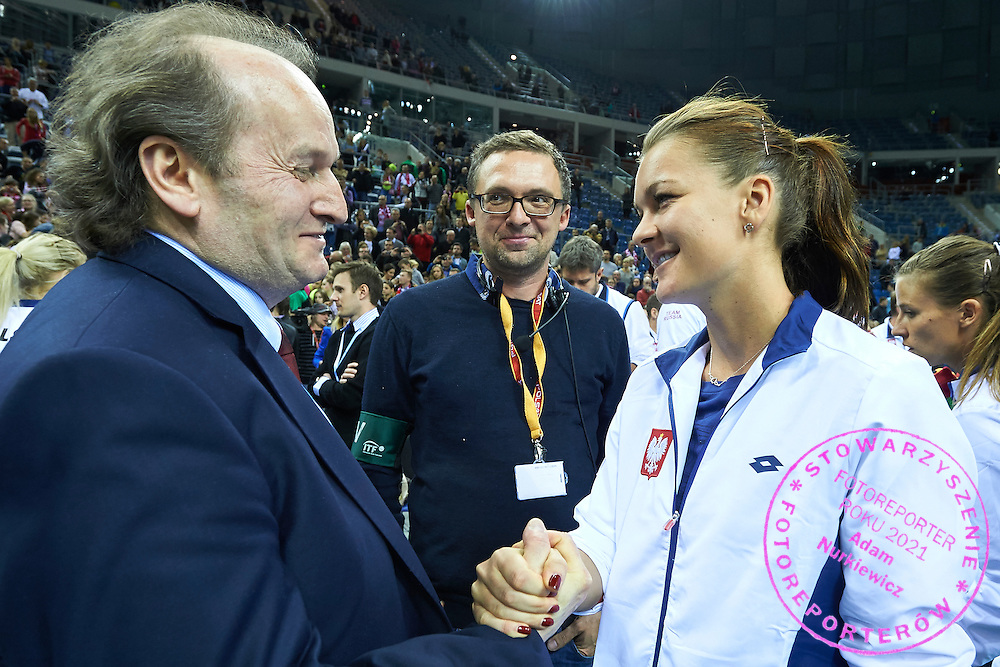 (L) Jacek Muzolf President of Polish Tennis Federation thanks for the game to (R) Agnieszka Radwanska from Poland during Second Day of the Fed Cup / World Group 1st round tennis match between Poland and Russia at Tauron Krakow Arena on February 8, 2015 in Cracow, Poland.<br /> <br /> Poland, Cracow, February 8, 2015<br /> <br /> Picture also available in RAW (NEF) or TIFF format on special request.<br /> <br /> For editorial use only. Any commercial or promotional use requires permission.<br /> <br /> Adam Nurkiewicz declares that he has no rights to the image of people at the photographs of his authorship.<br /> <br /> Mandatory credit:<br /> Photo by &copy; Adam Nurkiewicz / Mediasport
