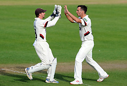 Somerset's Lewis Gregory and Alex Barrow celebrate the wicket of Durham's Scott Borthwick- Photo mandatory by-line: Harry Trump/JMP - Mobile: 07966 386802 - 12/04/15 - SPORT - CRICKET - LVCC County Championship - Day 1 - Somerset v Durham - The County Ground, Taunton, England.