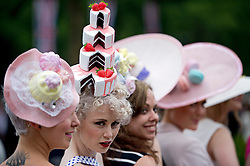 © London News Pictures. 20/06/2013. Ascot, UK.  Racegoers wearing elaborate hats  on Ladies Day on day three of Royal Ascot at Ascot racecourse in Berkshire, on June 20, 2013.  The 5 day showcase event,  which is one of the highlights of the racing calendar, has been held at the famous Berkshire course since 1711 and tradition is a hallmark of the meeting. Top hats and tails remain compulsory in parts of the course. Photo credit should read: Ben Cawthra/LNP