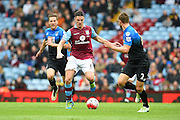 Aston Villa defender Ciaran Clark (6) during the Barclays Premier League match between Aston Villa and Bournemouth at Villa Park, Birmingham, England on 9 April 2016. Photo by Jon Hobley.