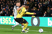 Millwall defender Mahlon Romeo (12) is challenged for the ball by Derby County forward Chris Martin (19) during the EFL Sky Bet Championship match between Derby County and Millwall at the Pride Park, Derby, England on 14 December 2019.