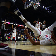 Malik Ellison, St. John's, lands awkwardly after driving to the basket defended by Chris Silva, South Carolina, during the St. John's vs South Carolina Men's College Basketball game in the Hall of Fame Shootout Tournament at Mohegan Sun Arena, Uncasville, Connecticut, USA. 22nd December 2015. Photo Tim Clayton