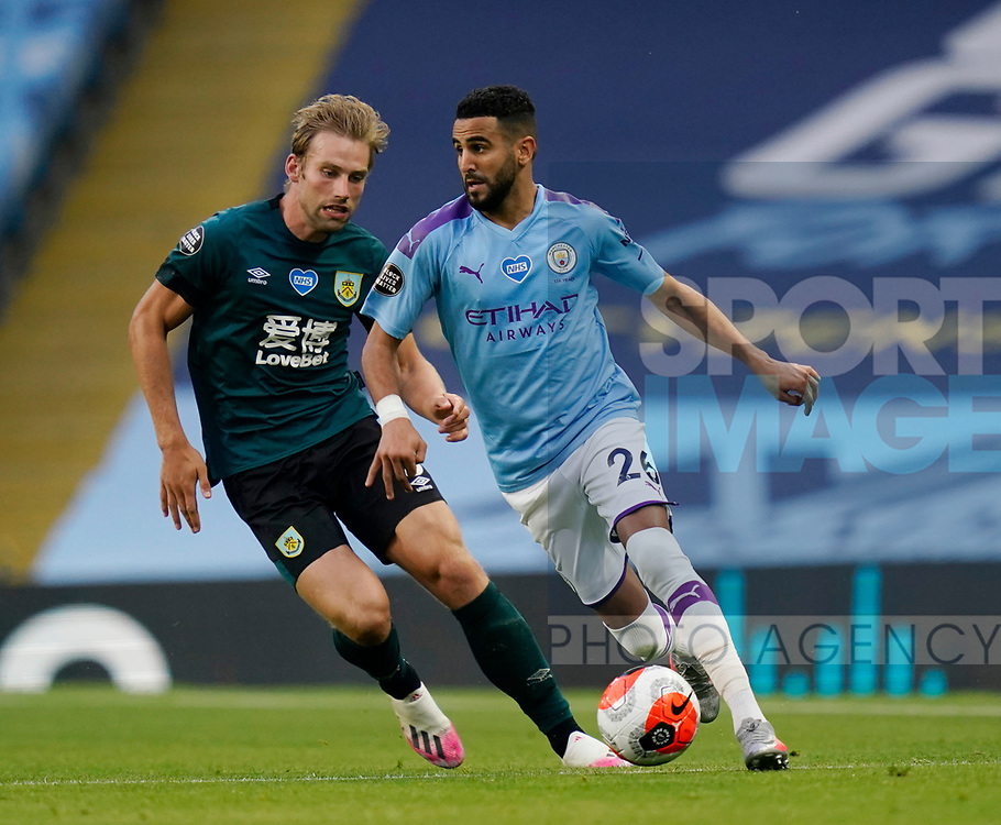 Charlie Taylor of Burnley turned by Riyad Marhez of Manchester City during the Premier League match at the Etihad Stadium, Manchester. Picture date: 22nd February 2020. Picture credit should read: Andrew Yates/Sportimage