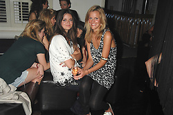 Left to right, LADY NATASHA RUFUS-ISAACS and ELIZABETH ACLAND at a party to launch the new upstairs area of Mamilanji, 107 Kings Road, London SW3 on 19th April 2007.<br />